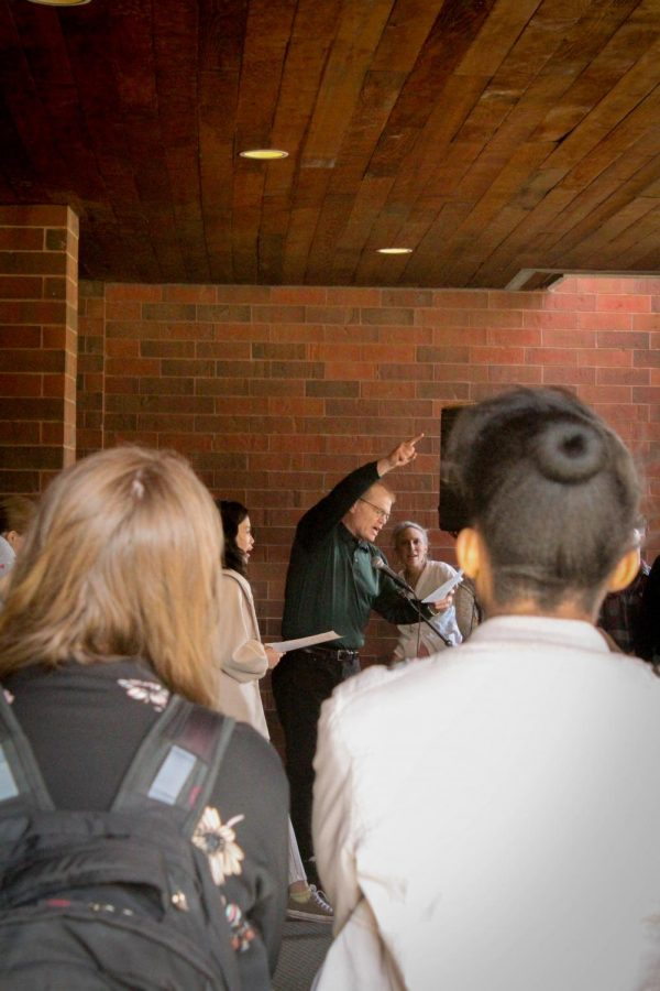 Campus Pastor Mike Blair leads students in an Interfaith prayer vigil.