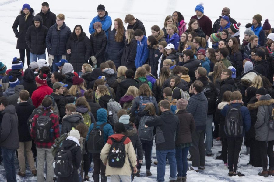 Students gather on the football field after the football field incident.