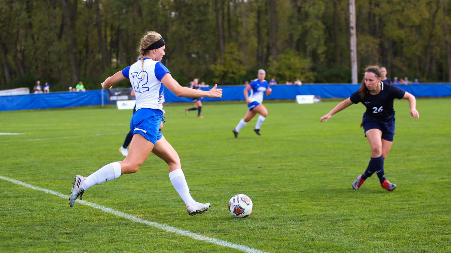 Marta Springer ('19) drives the ball against Wheaton College on Sept. 15. Luther lost 1-0, repeating the game they had against Wheaton in the 2017-18 season.