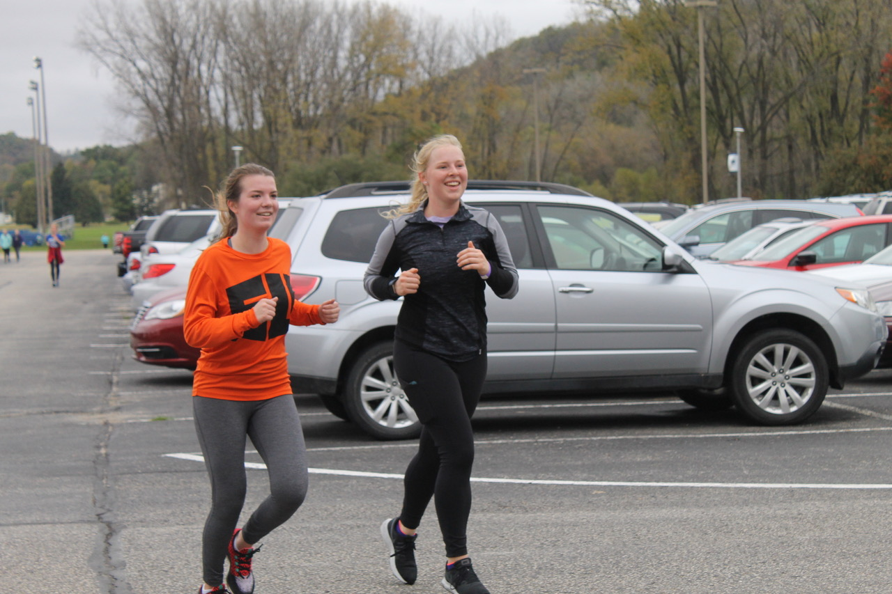 Anni Hedges ('22) and Meghan Rice ('22) participate in the Donut Dash.