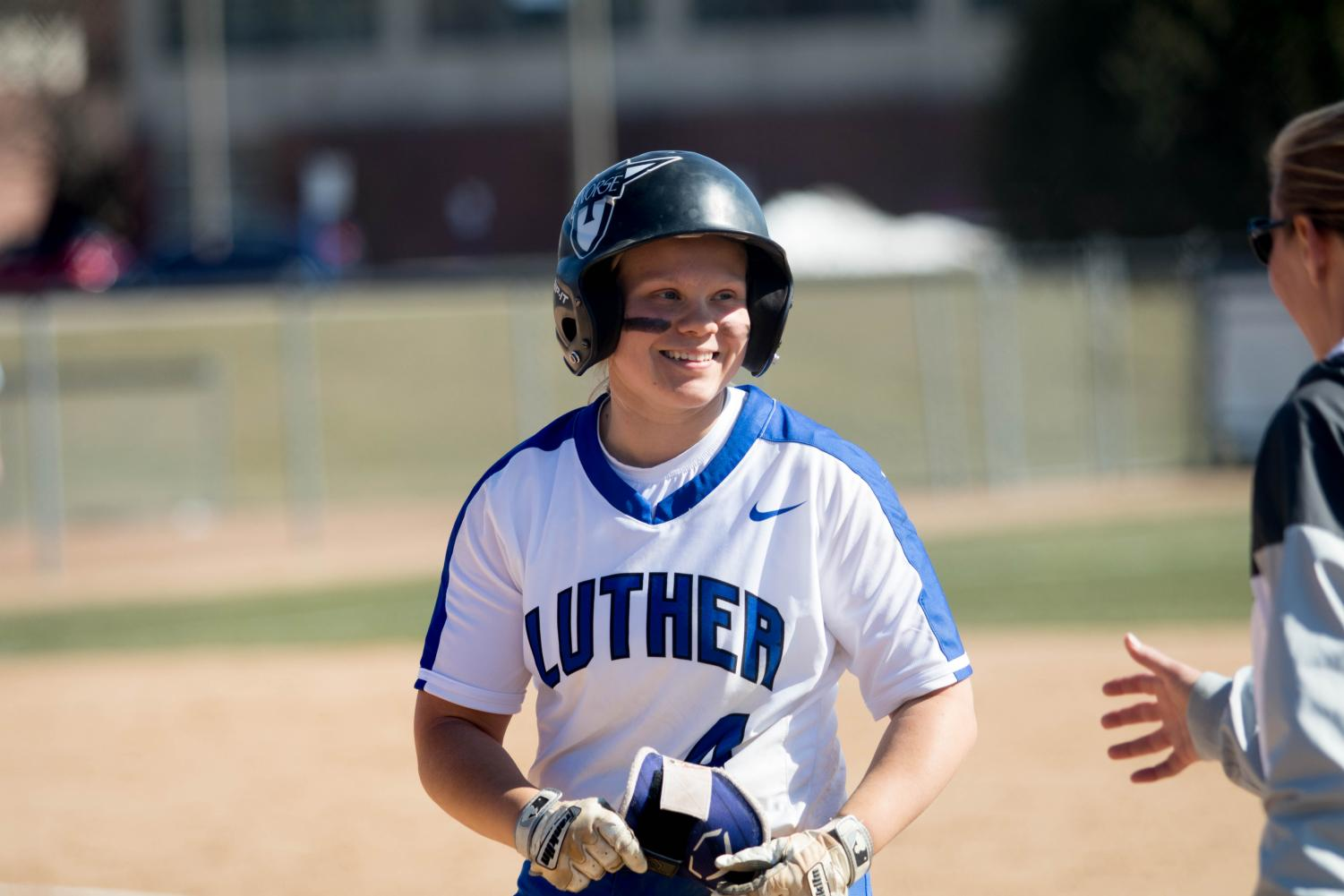Anna Strien ('18) rejoices after an RBI she hit during a game against Nebraska Wesleyan in the 2018 season.
