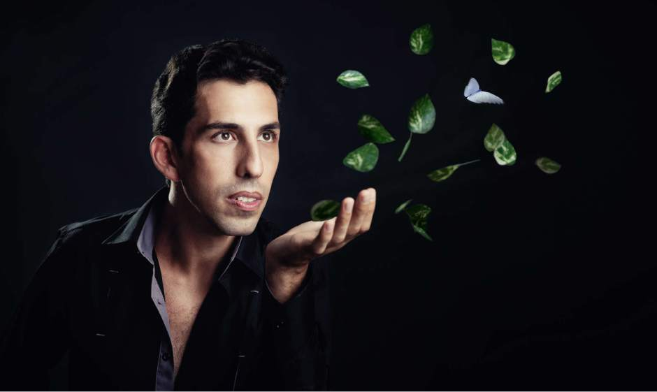 Vitaly uses images from the natural world, like leaves and butterflies, throughout his performance.