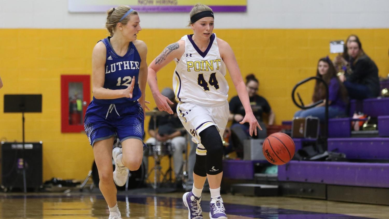Erin Saemrow ('21) chases down  the University of              Wisconsin-Stevens Point's Amber Baehman ('22) on Nov. 17.