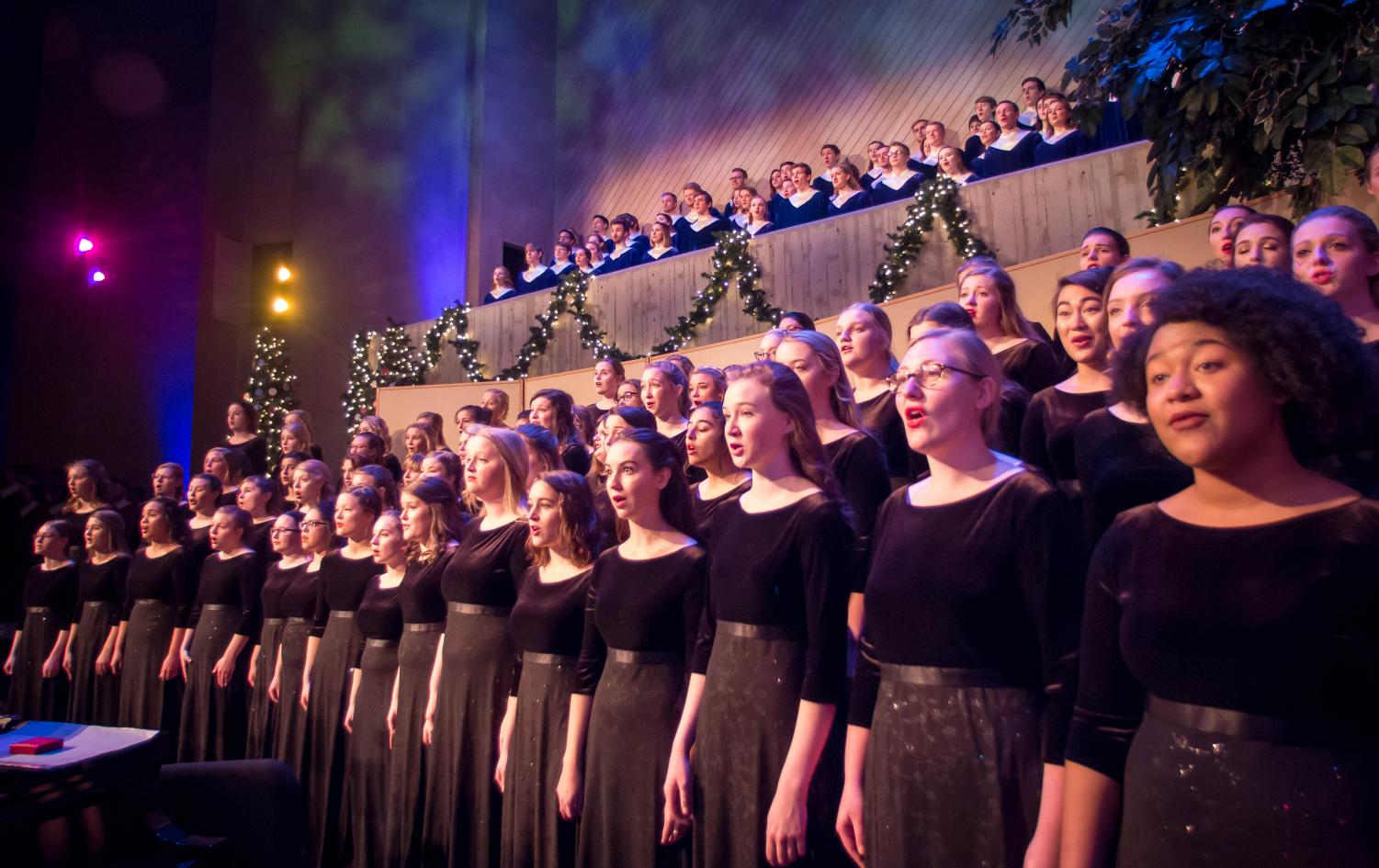 Aurora members perform in Christmas at Luther 2017 in their previous uniform of black dresses.