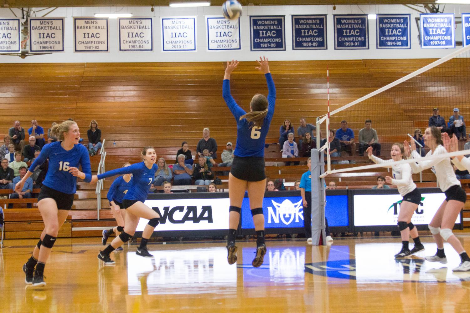 [LEFT TO RIGHT] Brooke Greenwood ('20), Emma Veum ('19), and Sam Sixta ('20) in a match against the University of Dubuque on Sept. 25.