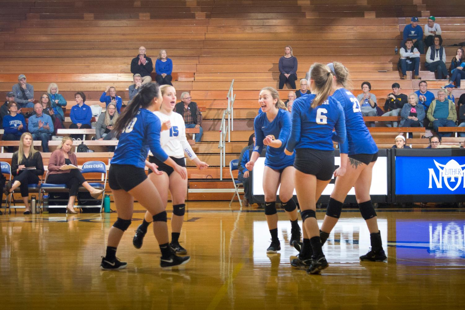 Grace Meyers ('22), Natalie Cote ('19), Anna Larson ('19), Katie Shabatura ('19), and Sam Sixta ('20) celebrate after a point against Loras College on Oct. 30.