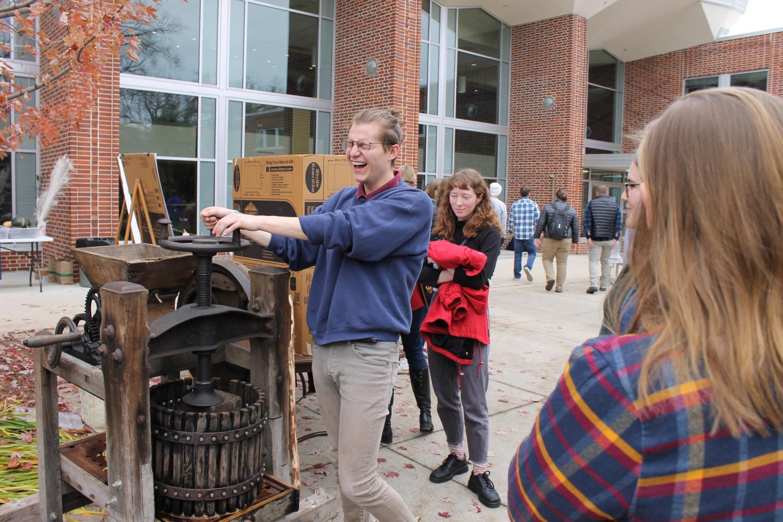 Sean McKenzie('20)  utilizes the cider press.