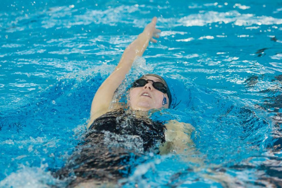 Jessica Olson ('21) swimming the backstroke during the  800 yard Freestyle Relay on Nov. 17. Luther finished third in this event in a time of 8:51.53.