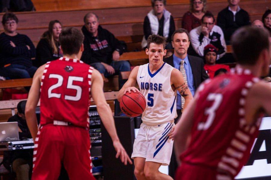 Gage Thompson ('21) dribbles the ball against Bethany Lutheran on Nov. 17. Thompson led all scorers in this game with 22 points.