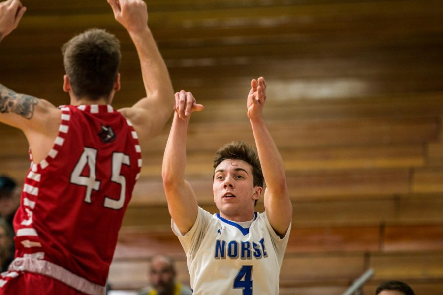 Anthony Westhusing ('21) shoots the ball in Luther's win against Bethany Lutheran College.