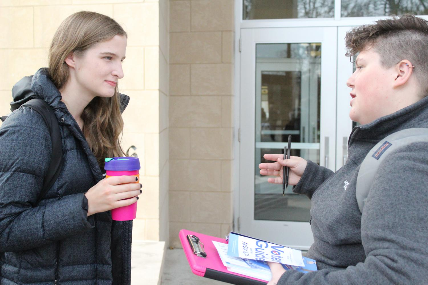 Laura Duffield ('21) stopped to listen to Sarah Wyatt ('20) provide information on the candidates.