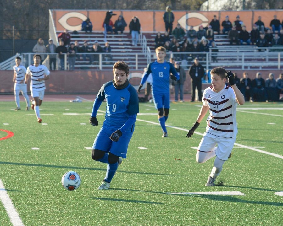 Brunno Colon ('19) kicks the ball in the game against the University of Chicago.