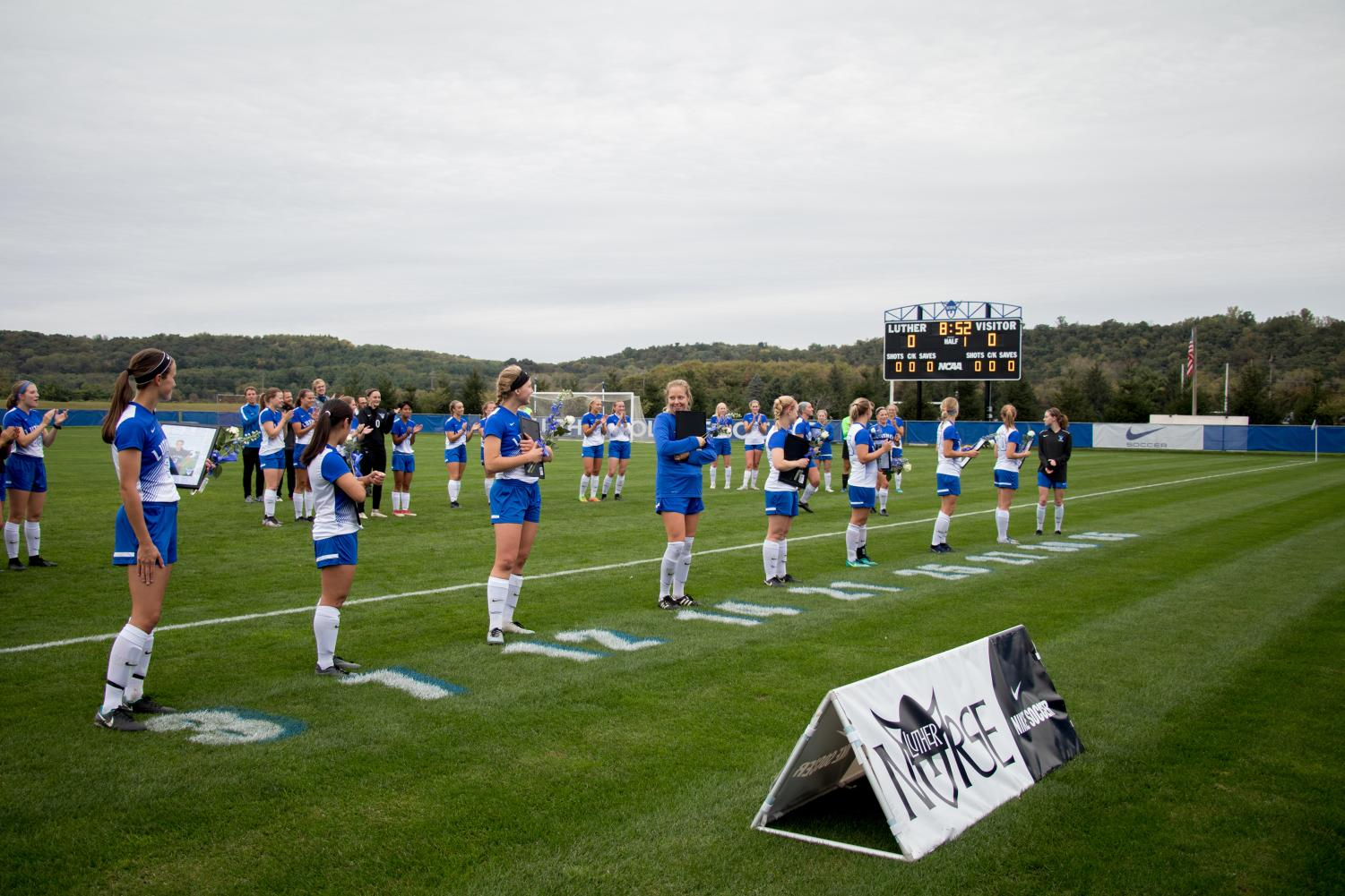 Senior women's soccer players are honored before their win over Buena Vista University on Sept. 29.