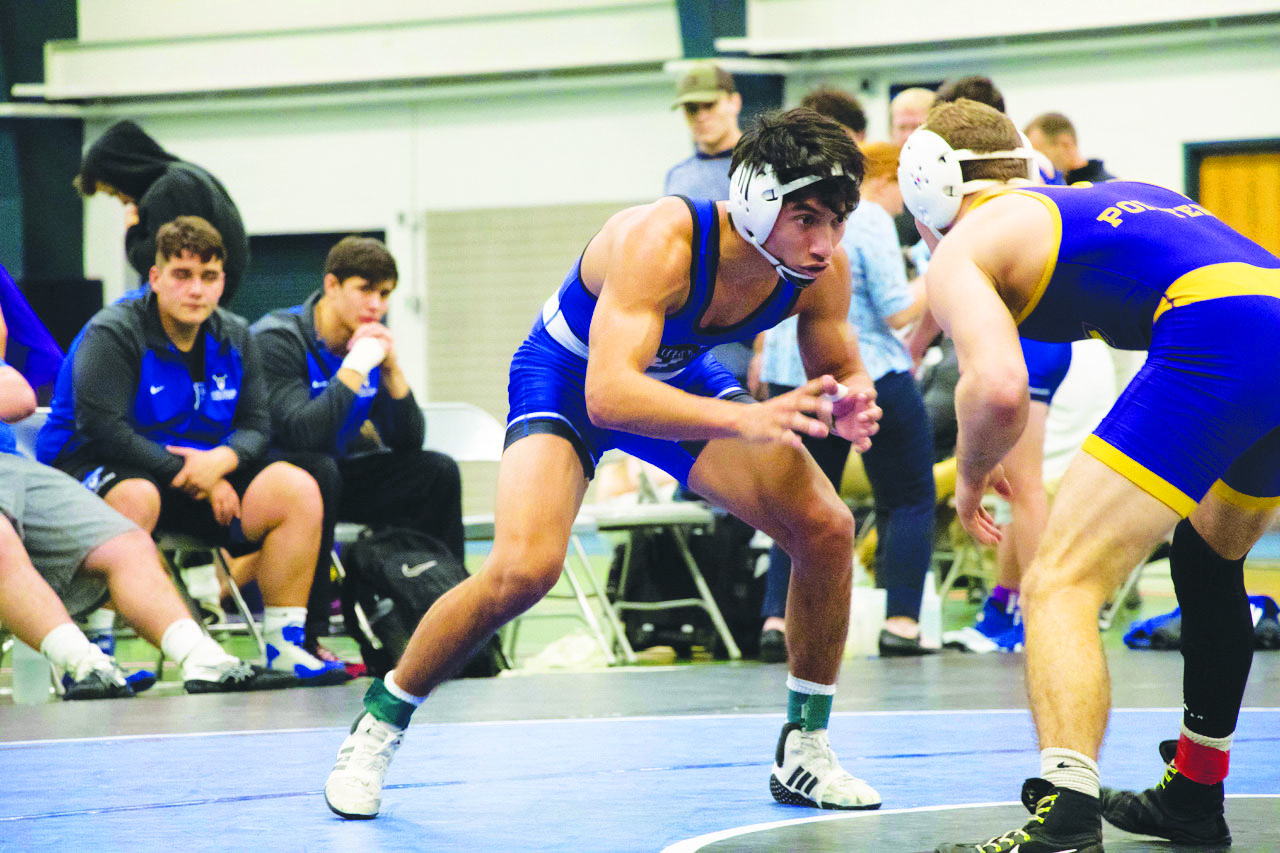 Tyler Difiore ('22) squares up against an opponent during University of Wisconsin-Stevens Point meet on Dec. 1.