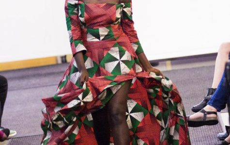 Lydia Juma ('21) walks the runway in her first ISAA International Fashion Show in 2017.