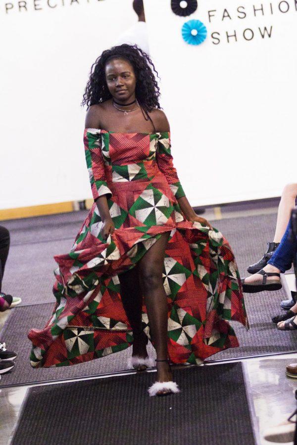 Lydia+Juma+%28%E2%80%9821%29+walks+the+runway+in+her+first+ISAA+International+Fashion+Show+in+2017.