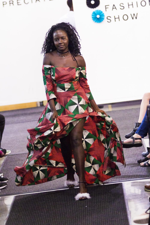 Lydia Juma ('21) walks the runway in her first ISAA International Fashion Show in 2017.