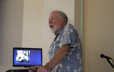 Marv Slind gives a presentation on musician, novelist, and entrepreneur Jimmy Buffet.