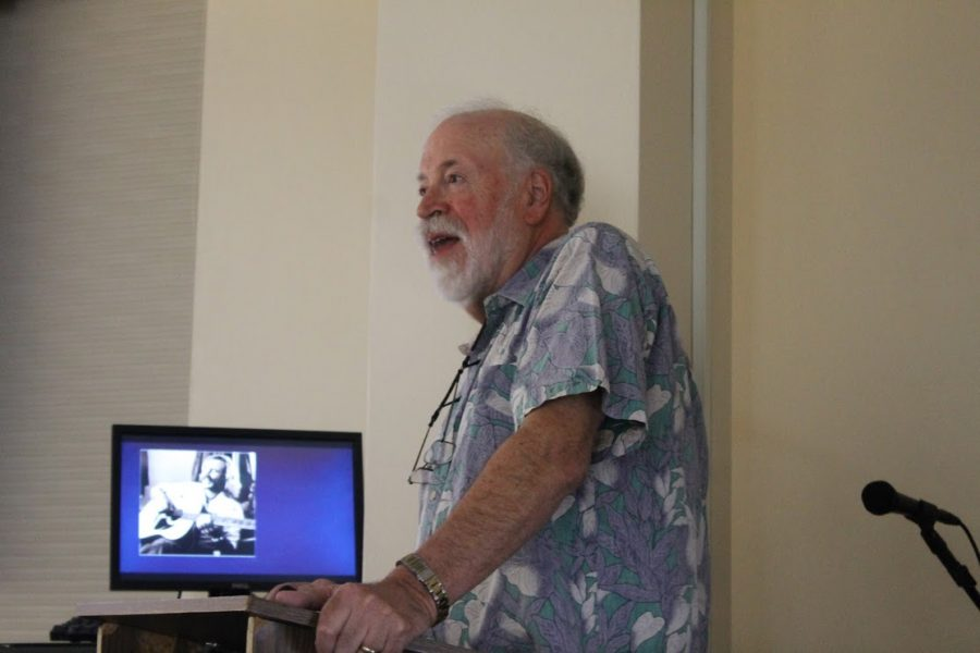 Marv Slind gives a presentation on musician, novelist, and entrepreneur Jimmy Buffet.