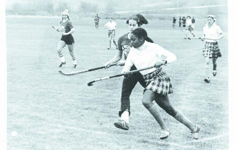 Field hockey team after Title IX, 1977. Terri Dean goes after the ball.