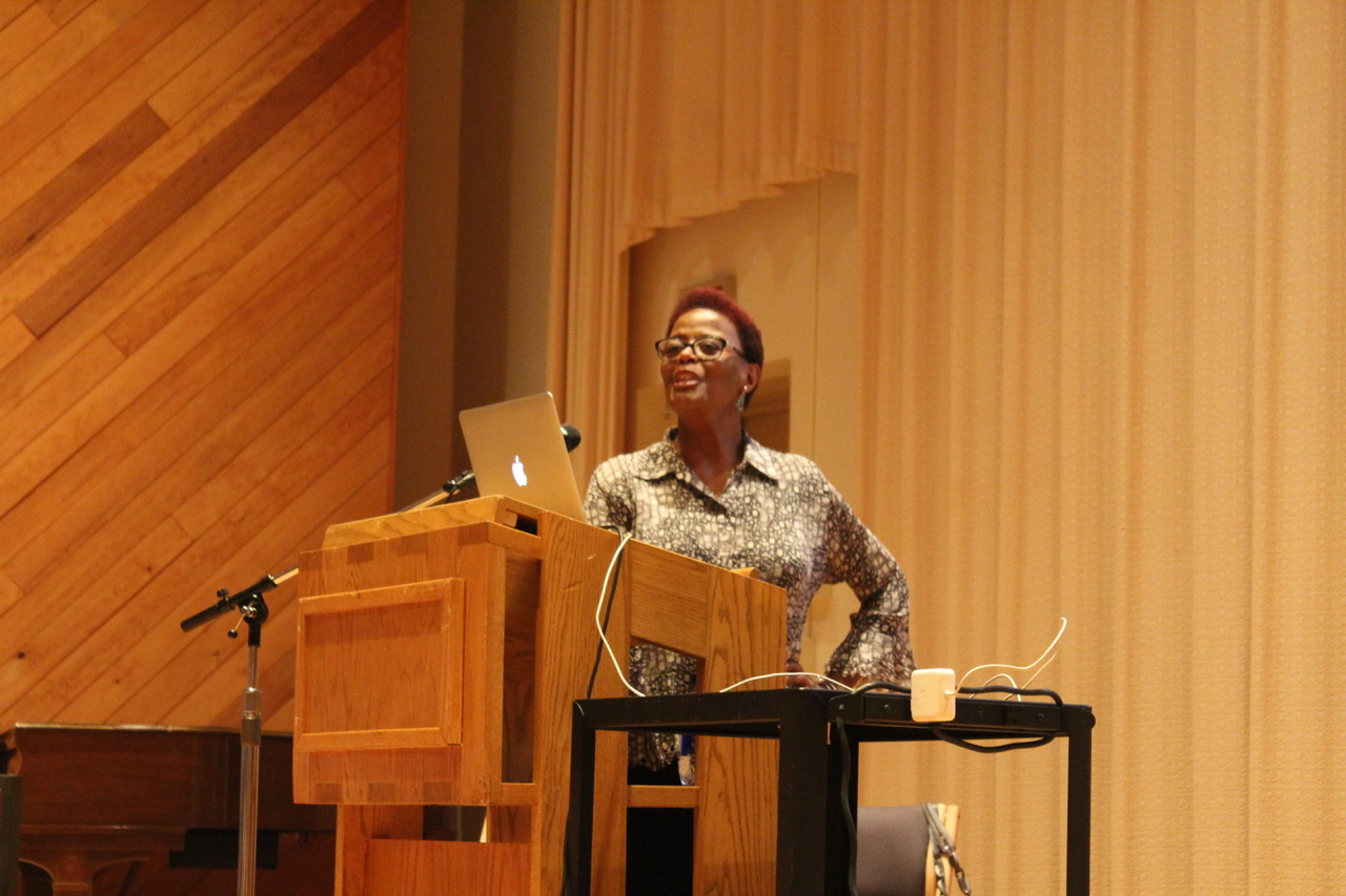 "Deborah Smith Pollard sings along to ""Oh Happy Day"" during her lecture."