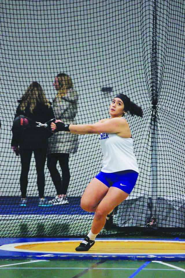 Mariah Balajadia ('21) throws hammer at the Indoor Alumni meet on February 1.