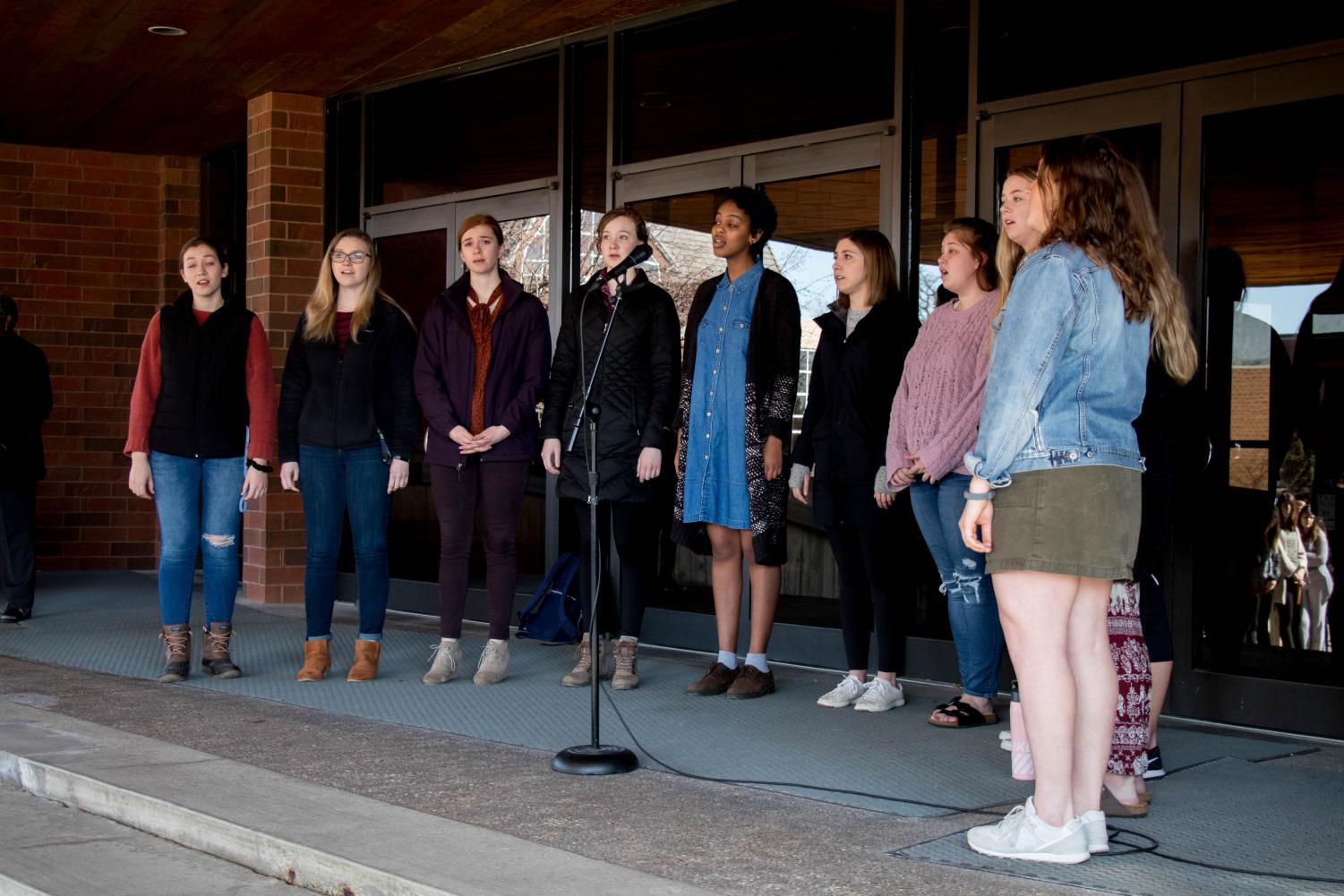 A capella group, Beautiful Mess, performs a song in support of the victims being honored at the vigil.
