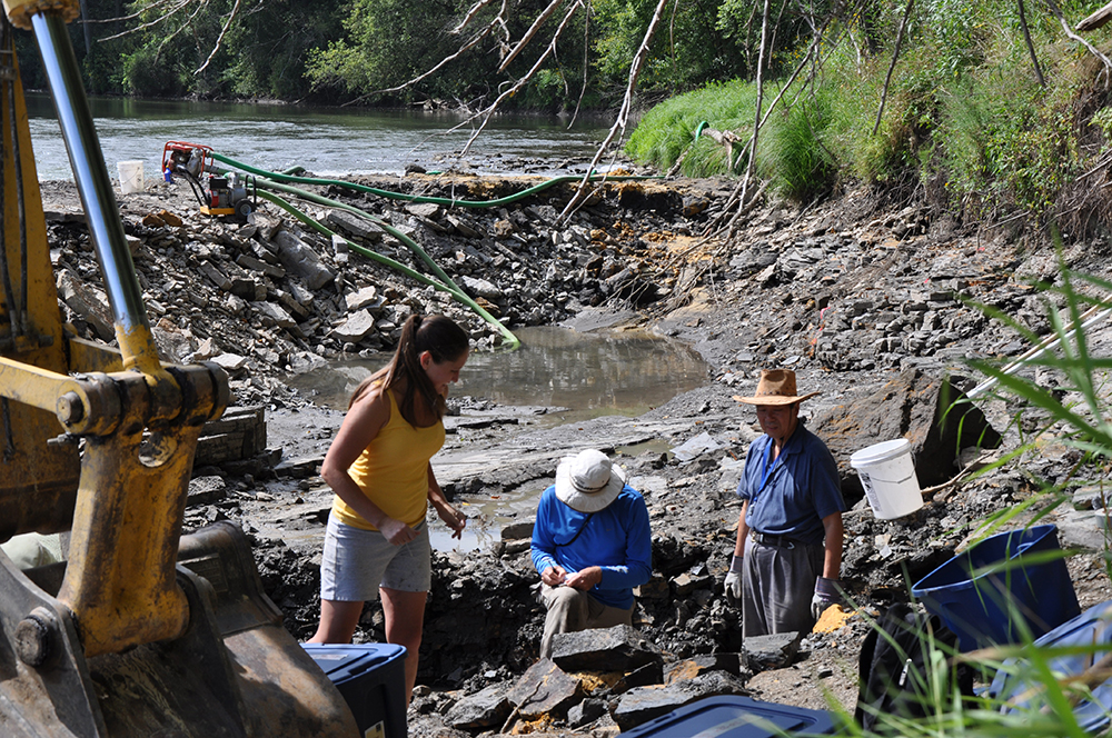 Geologists Carrie Davis, Paul Liu, and Robert McKay complete research at the Iowa River excavation site in 2010.