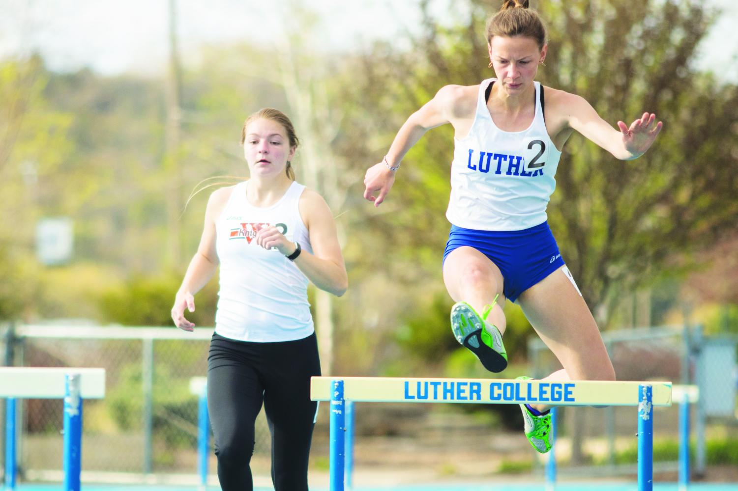 Grace Herber ('22) strides over a hurdle in the 400 meter hurdles at the Wartburg Dual on Thursday, May 2.