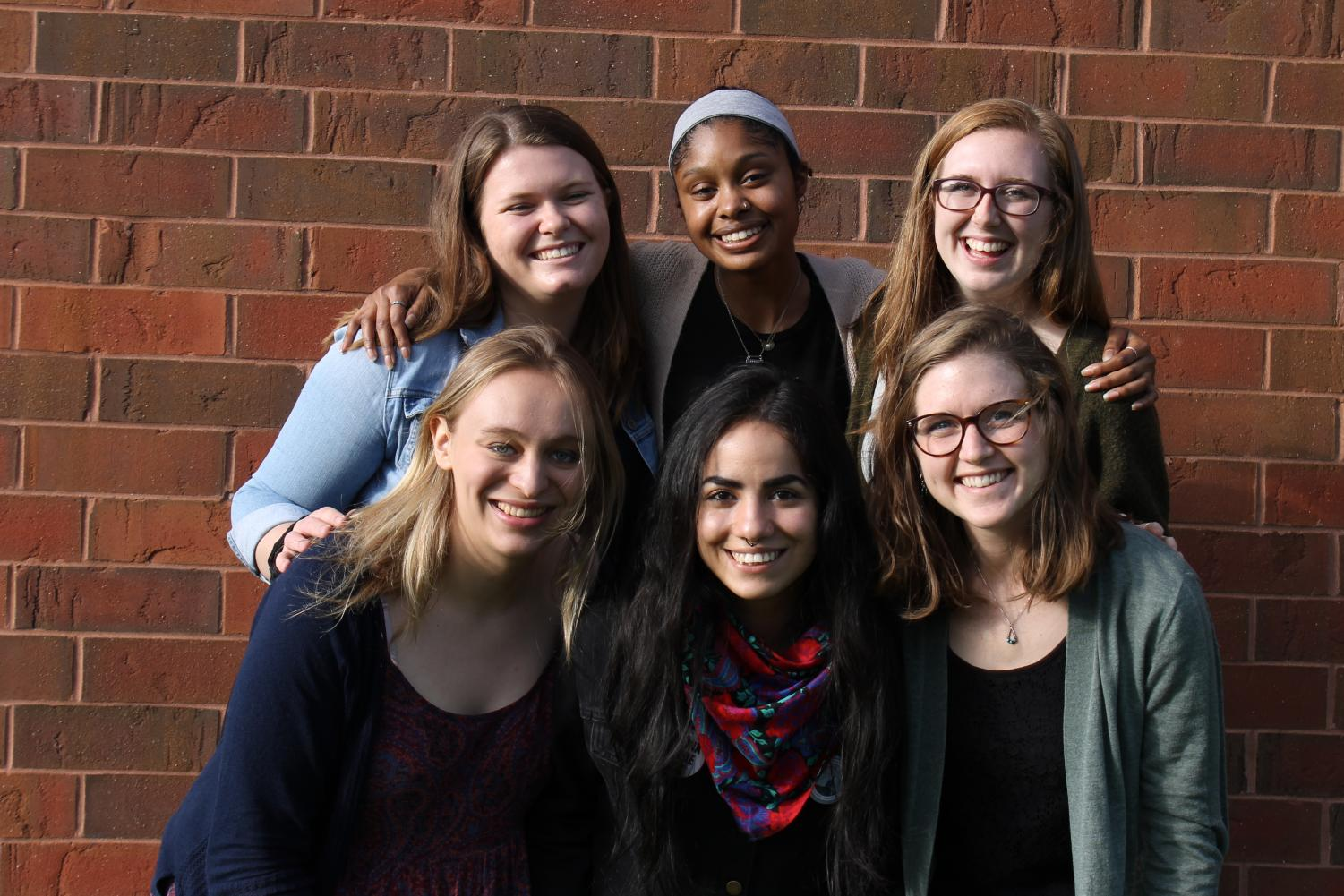 The senior editorial staff is composed of [LEFT TO RIGHT, TOP TO BOTTOM] Lyndsay Monsen ('19), Shasa Sartin ('19), Elyse Grothaus ('19), Katrina Meyer ('19), Ana López ('19), and Martel DenHartog ('19).