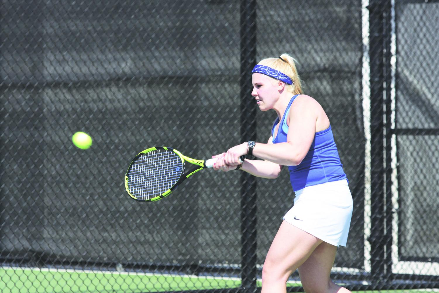 Britta Pressler ('19) hits a backhand during a game over spring break.