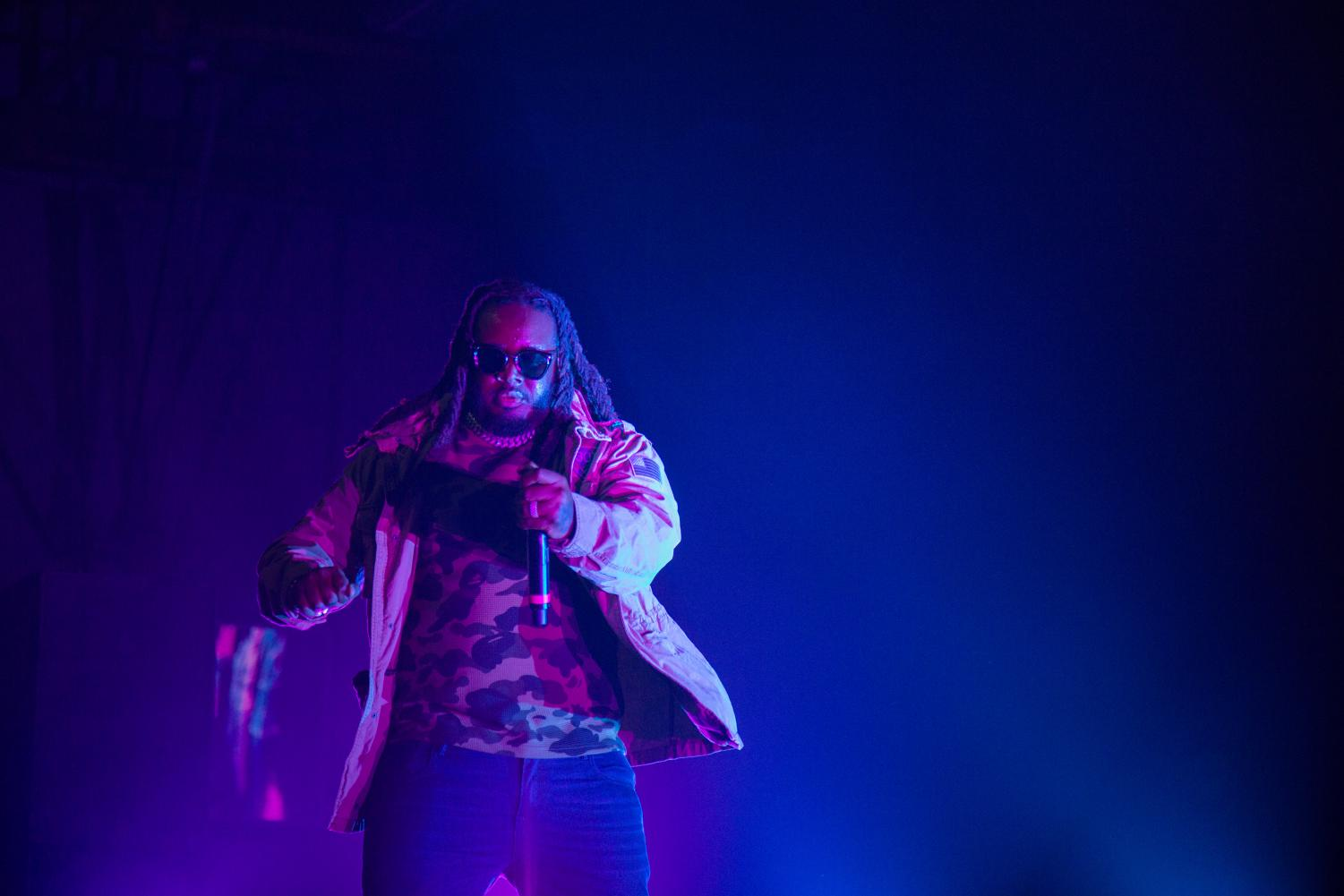 T-Pain shows off his dance moves onstage in the Regents Center.