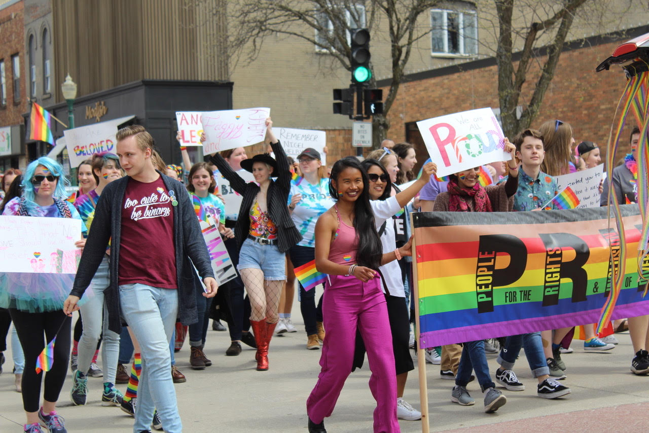 A group of Luther students march in the Decorah Pride parade.