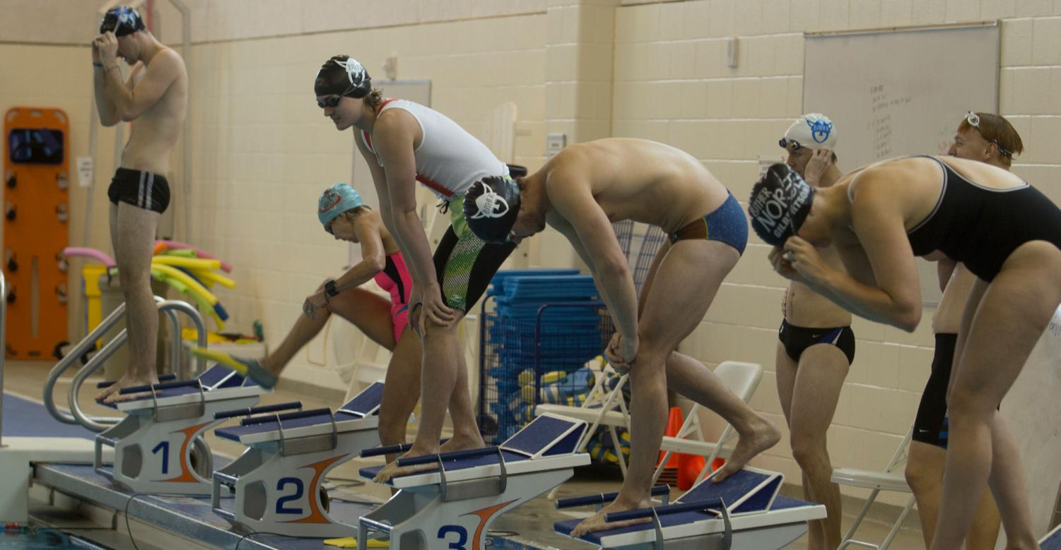 Luther students and alumni prepare to swim at the alumni meet in 2018.