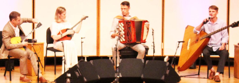Russian Renaissance members Ivan Kuznetov, Anastasia Zakharova, Alexander Tarasov, and Ivan Vinogradov prepare to play their next piece.