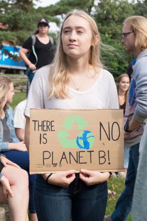 Carolyn Wrightsman ('22) holds a sign at the Climate Strike on Bentdahl Commons.