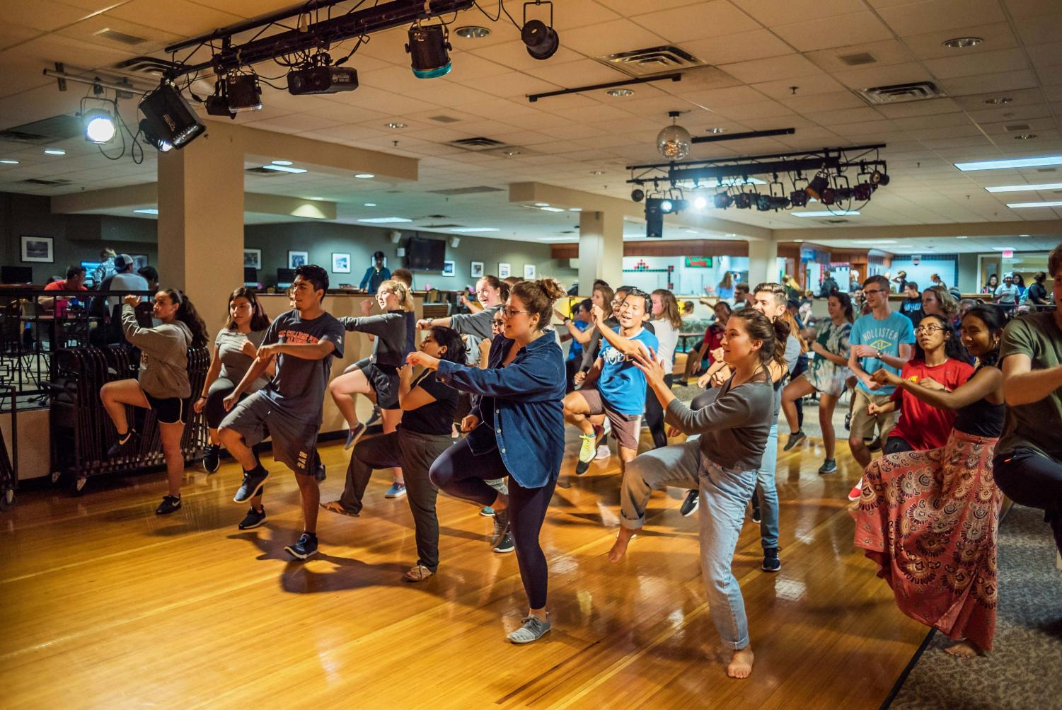 Students participate in zumba class in Marty's