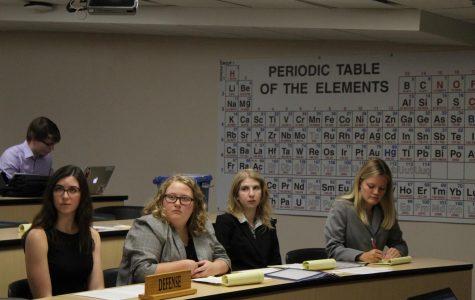 Theresa Easley ('22), Jocelyn Defauw ('23), Maddie Gregurek ('22), and Sadie Pichelmann ('23) watch Peter Stelter's ('21) argument.
