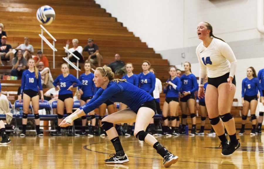 Paige Yontz ('20) bumps the ball to a teammate while her teammates look on.