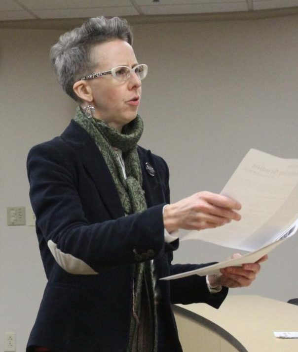 Associate Professor of Philosophy Holly Moore hands out informational fliers at the identity studies student forum on Nov.5.