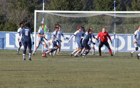 Goalie Carson Davenport ('21) and several team members prepare for a corner kick.