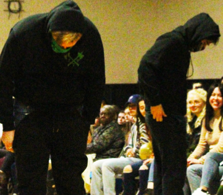 Members of Zeta Tau Psi participate in a toxic masculinity piece at the ISAA fashion show.
