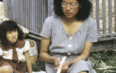 A woman and child weave baskets at the Bethany Indian Mission in 1953