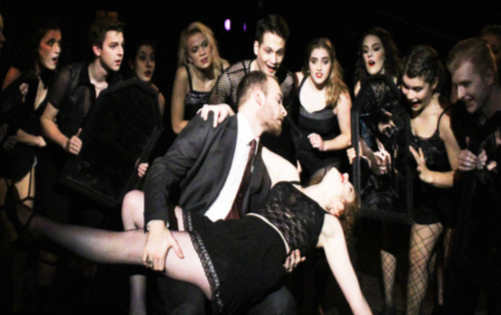 Linny Briggs ('22) who plays Roxie Hart, dances with Trevor Haren ('21) in one of the scenes.