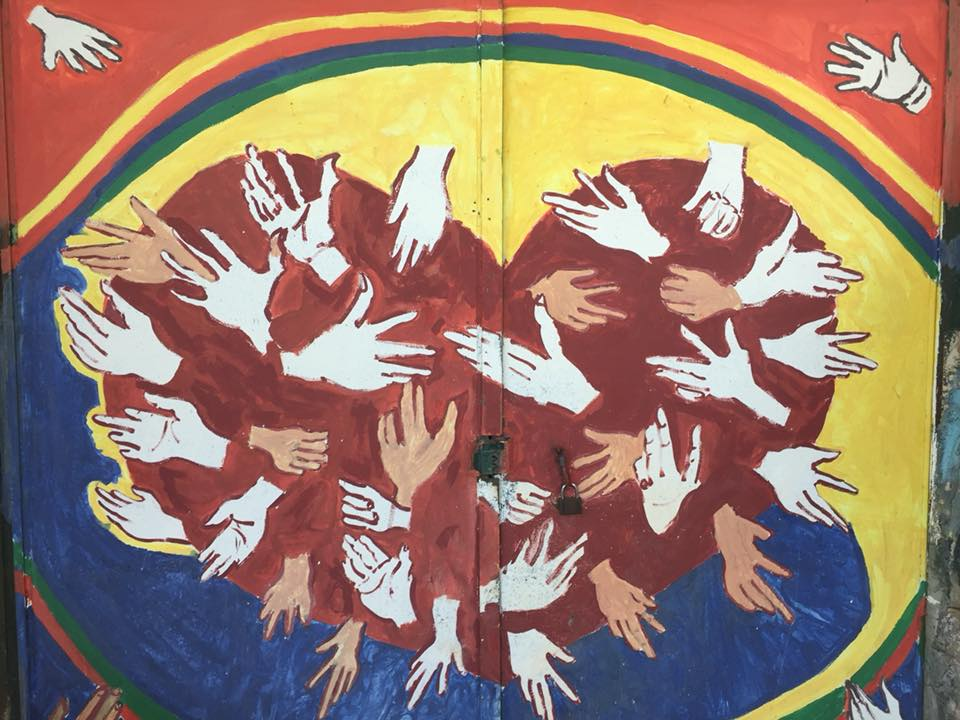 Children painted a section of a door on the Nassar family farm during a Tent of Nations summer camp.