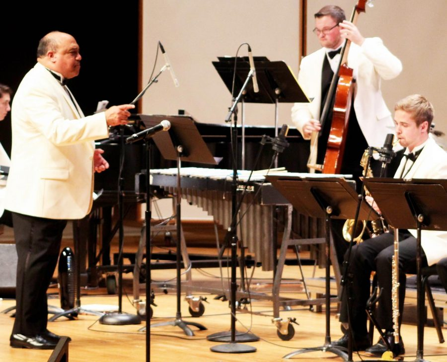 Guzmán conducts members of the Jazz Orchestra before a show
