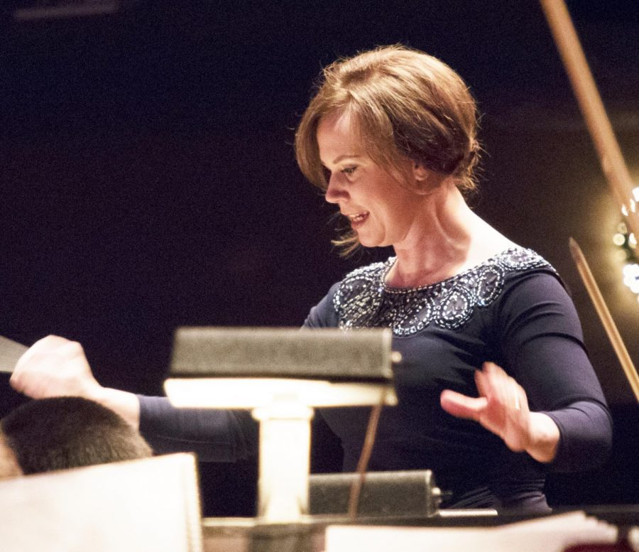Associate Professor of Music Jennaya Robison ('96) conducting during Christmas at Luther.