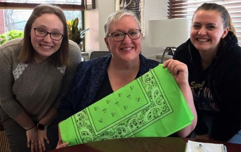 President Jenifer Ward helped Hannah Wollack ('20) (left) and Samantha Morgan ('20) (right) promote the project.
