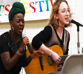 Fezile Mnisi ('20) and Brooke Prohaska ('21) perform a duet.
