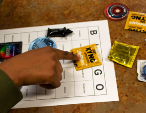 Students used condoms and lube as place markers during Condom Bingo.